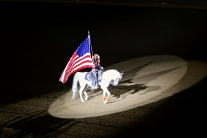 Thunder carrying the flag in the National Western Stock Show grand entry. Photo courtesy of Arabian Horse Association.