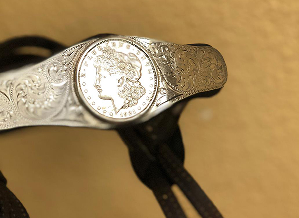 The antique silver dollars in this headstall date back to 1921.