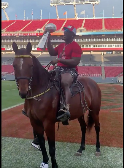 Tampa Bay Buccaneer, Devin White, Rides His Horse Around Stadium to Celebrate Super Bowl Win