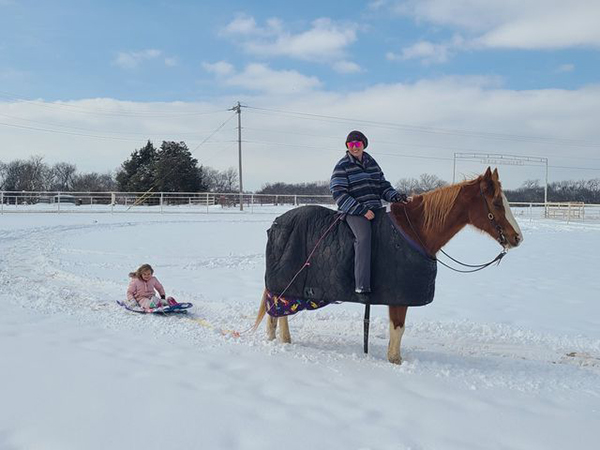 EC Photo of the Day- Snow Day Sled Ride